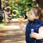 how to be happy find your flow - child blowing bubbles